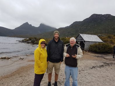 Group tour with guide on misty day at Dove Lake in the Cradle Mountain National Park
