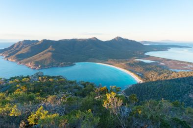 Aerial view of picturesque beach and mountains on sunny morning. Freycinet Park Tasmania. Australia